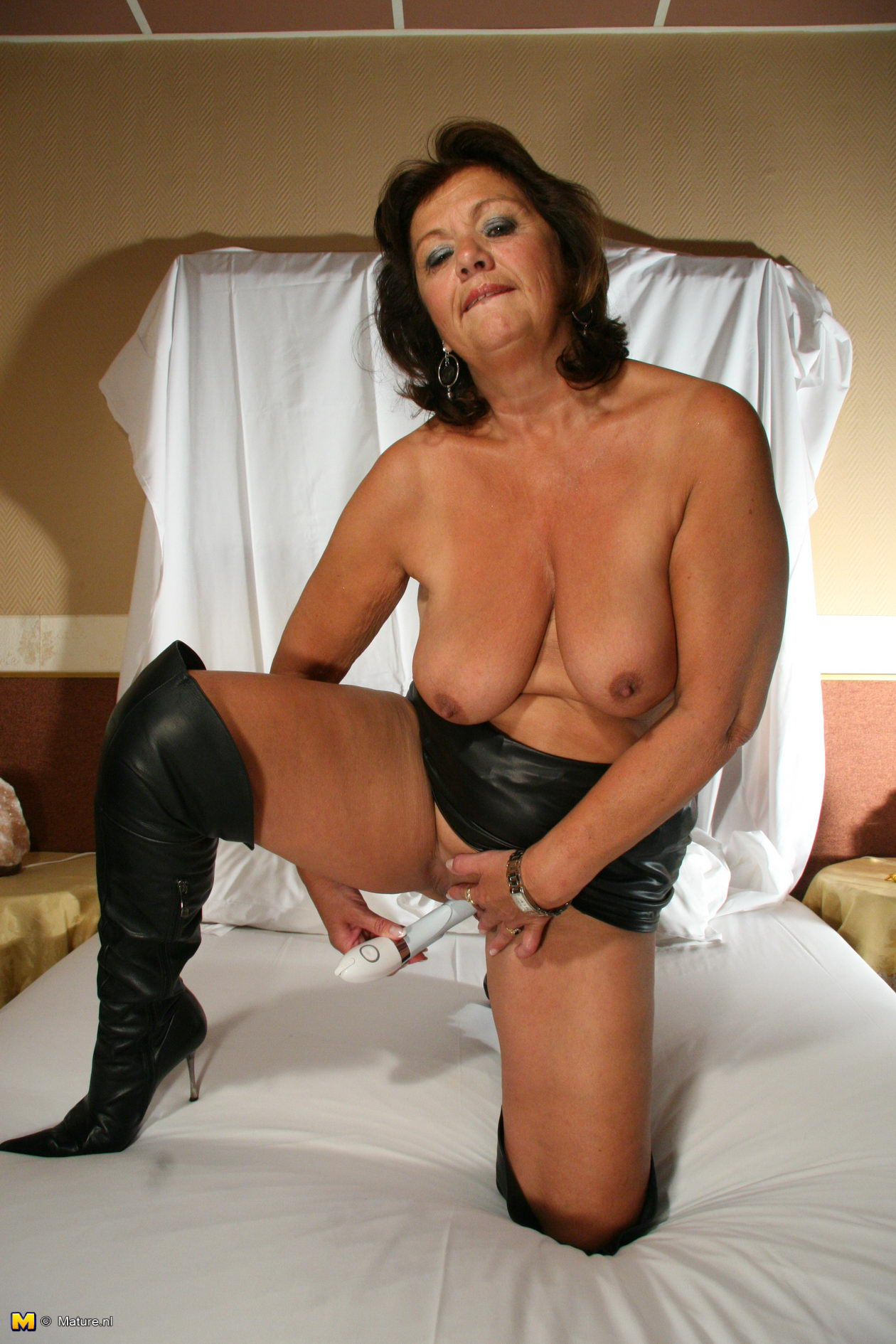 sexy granny in black boots posing for us